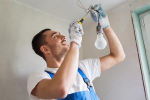 man-fixing-light